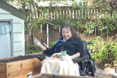 resident with a ventilator gardening
